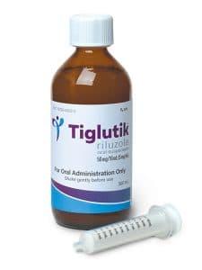 Bottle of Tiglutik (riluzole) with syringe